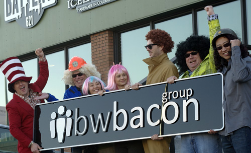 bacon team holding sign with logo