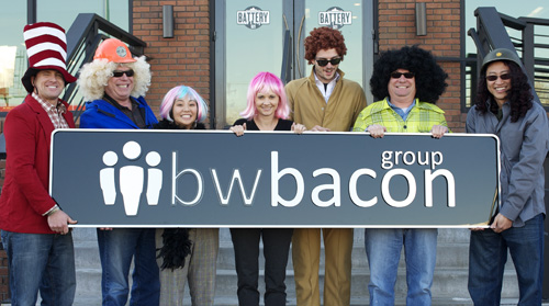 bwbacon team holding sign with logo