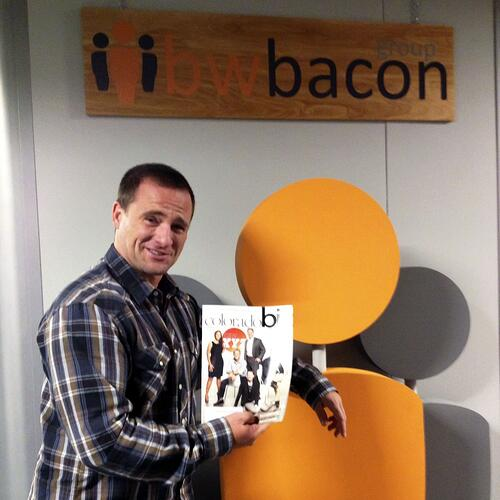 Dave Bacon holding ColoradoBiz Magazine's October 2012 issue of the 250 Top Private Colorado Companies